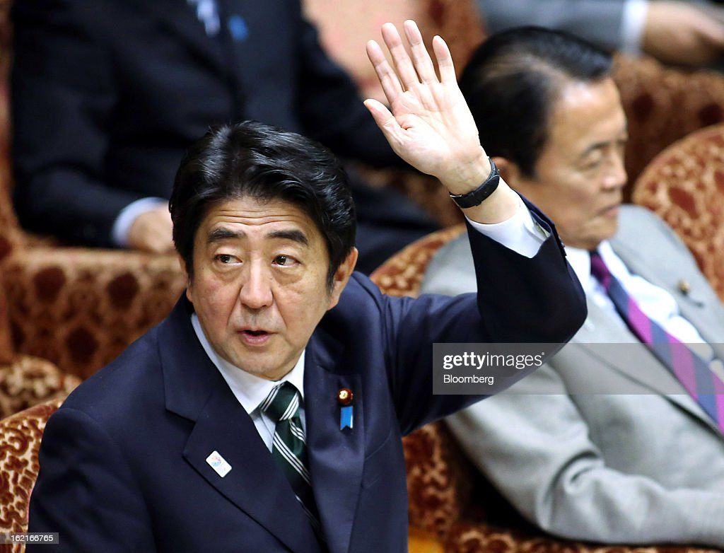 <a gi-track='captionPersonalityLinkClicked' href=/galleries/search?phrase=Shinzo+Abe&family=editorial&specificpeople=559017 ng-click='$event.stopPropagation()'>Shinzo Abe</a>, Japan's prime minister, raises his hand to answer a question during a budget committee session at the upper house of parliament in Tokyo, Japan, on Wednesday, Feb. 20, 2013. Abe said that the need to buy foreign bonds has decreased, backing away from a policy proposal that may be seen by other nations as a direct attempt to weaken the yen. Photographer: Haruyoshi Yamaguchi/Bloomberg via Getty Images