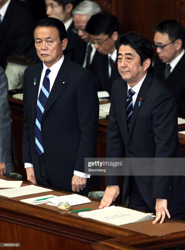 <a gi-track='captionPersonalityLinkClicked' href=/galleries/search?phrase=Shinzo+Abe&family=editorial&specificpeople=559017 ng-click='$event.stopPropagation()'>Shinzo Abe</a>, Japan's prime minister, right, and <a gi-track='captionPersonalityLinkClicked' href=/galleries/search?phrase=Taro+Aso&family=editorial&specificpeople=559212 ng-click='$event.stopPropagation()'>Taro Aso</a>, Japan's deputy prime minister and finance minister, attend the opening session of the Diet at the lower house of parliament in Tokyo, Japan, on Monday, Jan. 28, 2013. Abe's government predicts that tax revenue will exceed cash raised from bond sales for the first time in four years as the nation's economy emerges from last year's recession. Photographer: Haruyoshi Yamaguchi/Bloomberg via Getty Images