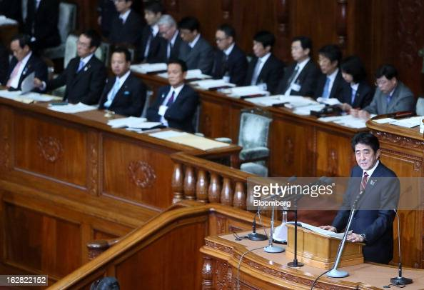 Shinzo Abe Japan's prime minister right delivers his policy speech at the lower house of Parliament in Tokyo Japan on Thursday Feb 28 2013 Abe...