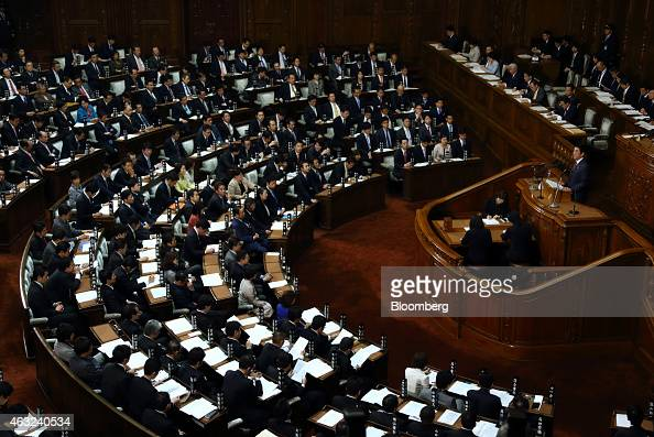Shinzo Abe Japan's prime minister right delivers his policy speech at the lower house of parliament in Tokyo Japan on Thursday Feb 12 2015 Abe said...