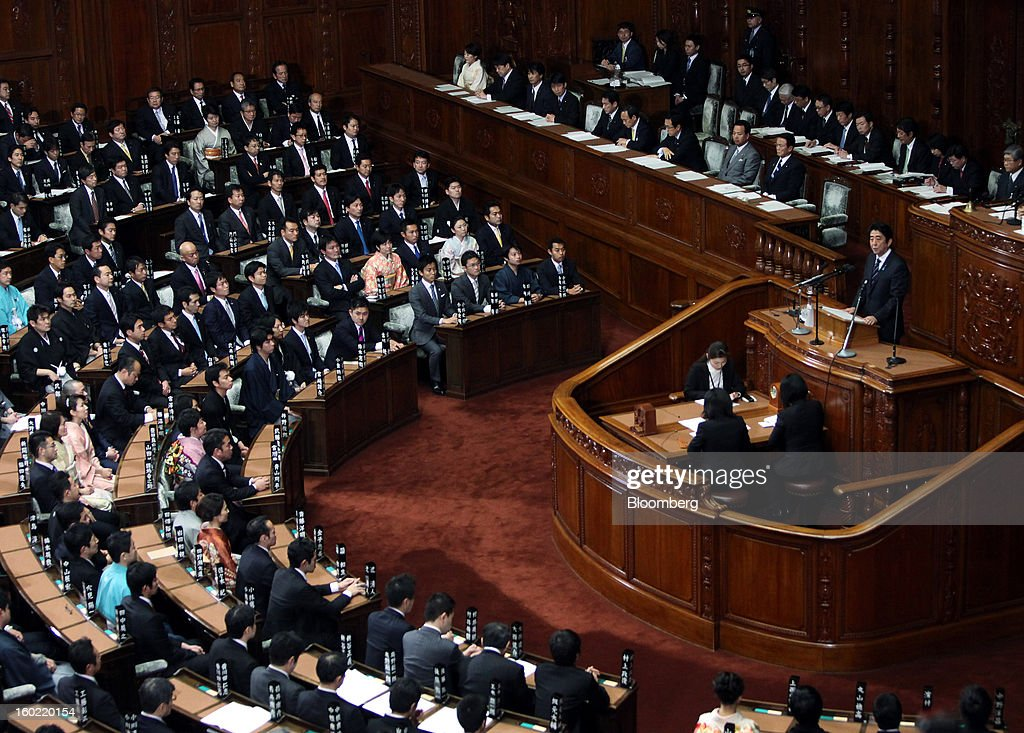 <a gi-track='captionPersonalityLinkClicked' href=/galleries/search?phrase=Shinzo+Abe&family=editorial&specificpeople=559017 ng-click='$event.stopPropagation()'>Shinzo Abe</a>, Japan's prime minister, right, delivers his policy speech during the opening session of the Diet at the lower house of parliament in Tokyo, Japan, on Monday, Jan. 28, 2013. Abe's government predicts that tax revenue will exceed cash raised from bond sales for the first time in four years as the nation's economy emerges from last year's recession. Photographer: Haruyoshi Yamaguchi/Bloomberg via Getty Images