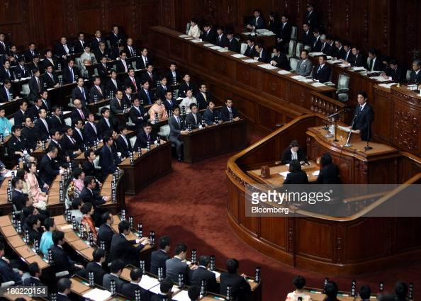 Shinzo Abe Japan's prime minister right delivers his policy speech during the opening session of the Diet at the lower house of parliament in Tokyo...