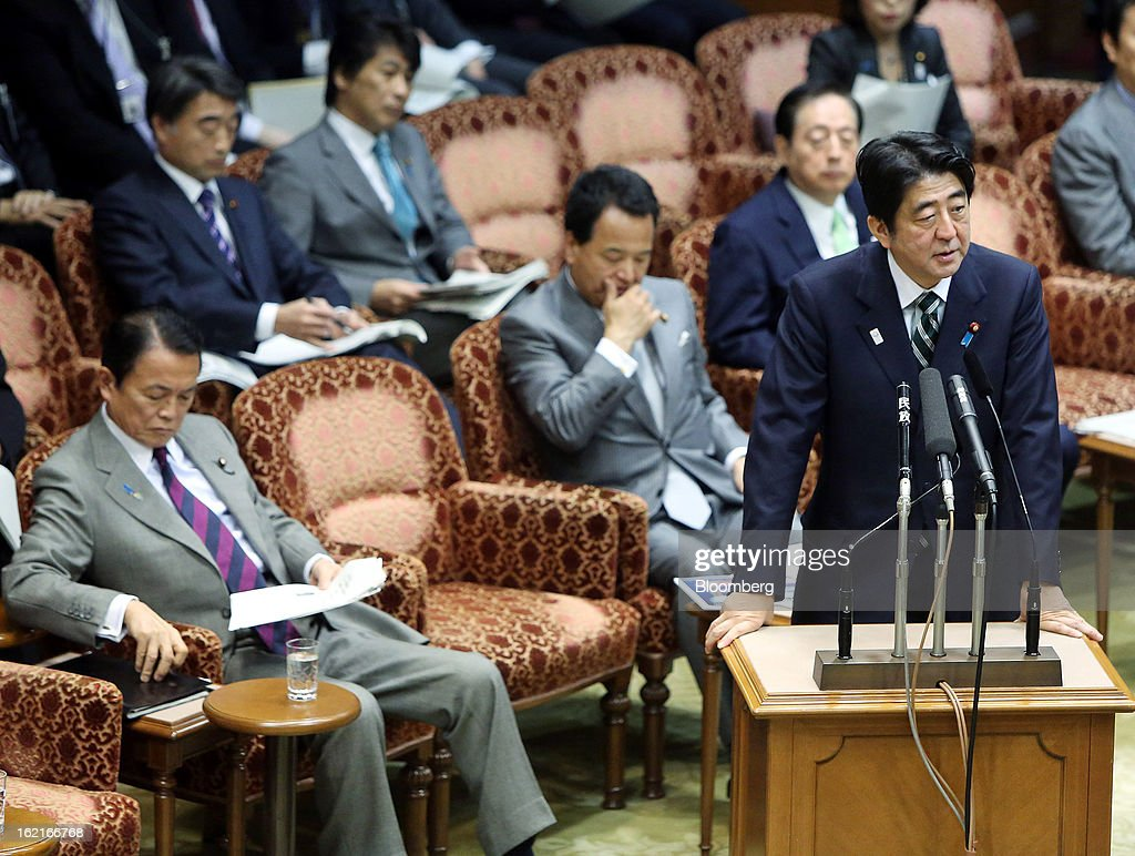 <a gi-track='captionPersonalityLinkClicked' href=/galleries/search?phrase=Shinzo+Abe&family=editorial&specificpeople=559017 ng-click='$event.stopPropagation()'>Shinzo Abe</a>, Japan's prime minister, right, speaks as <a gi-track='captionPersonalityLinkClicked' href=/galleries/search?phrase=Taro+Aso&family=editorial&specificpeople=559212 ng-click='$event.stopPropagation()'>Taro Aso</a>, Japan's deputy prime minister and finance minister, left, listens during a budget committee session at the upper house of the parliament in Tokyo, Japan, on Wednesday, Feb. 20, 2013. Abe said that the need to buy foreign bonds has decreased, backing away from a policy proposal that may be seen by other nations as a direct attempt to weaken the yen. Photographer: Haruyoshi Yamaguchi/Bloomberg via Getty Images
