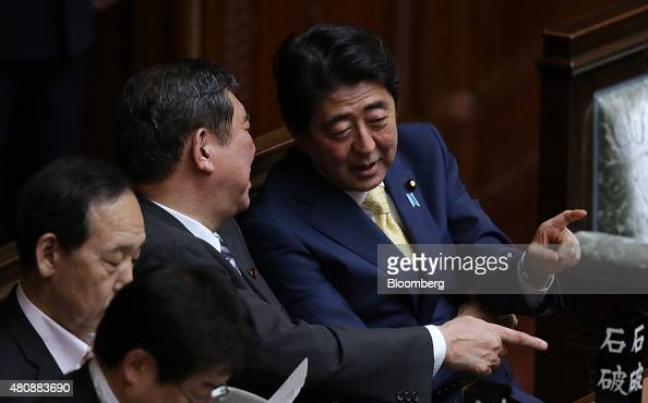 Shinzo Abe Japan's prime minister right speaks with Shigeru Ishiba minister in charge of regional revitalization center during a plenary session at...
