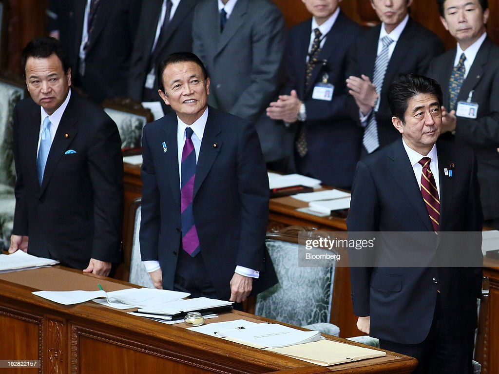 Shinzo Abe, Japan's prime minister, right, Taro Aso, Japan's deputy prime minister and finance minister, center, and Akira Amari, Japan's economic revitalization minister, attend a session at the lower house of Parliament in Tokyo, Japan, on Thursday, Feb. 28, 2013. Abe nominated Asian Development Bank President Haruhiko Kuroda to lead the nation's central bank, raising the likelihood of further monetary stimulus this year. Photographer: Haruyoshi Yamaguchi/Bloomberg via Getty Images