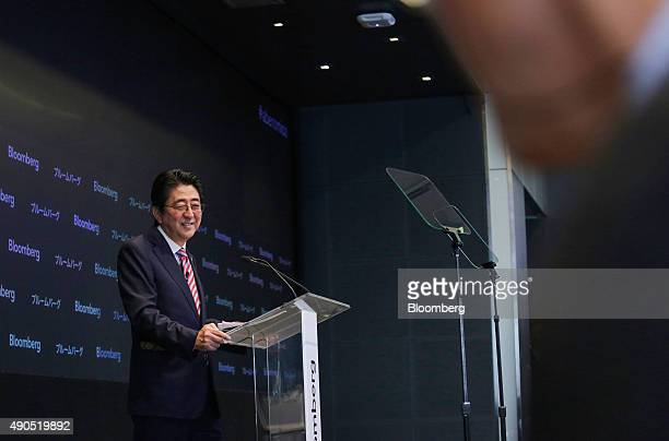 Shinzo Abe Japan's prime minister smiles while speaking during the Japan Finance Forum event in New York US on Tuesday Sept 29 2015 Abe pledged to...