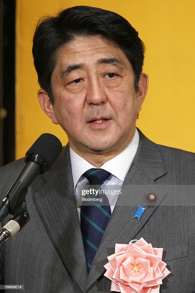Shinzo Abe, Japan's prime minister, speaks during a New Year's party for business leaders in Tokyo, Japan, on Monday, Jan. 7, 2013. The Japanese government will announce around 12 trillion yen ($136 billion) in fiscal stimulus measures to boost the nation's shrinking economy, Japanese media reported today. Photographer: Kiyoshi Ota/Bloomberg via Getty Images