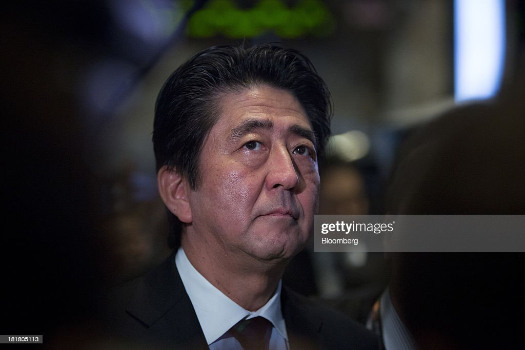 <a gi-track='captionPersonalityLinkClicked' href=/galleries/search?phrase=Shinzo+Abe&family=editorial&specificpeople=559017 ng-click='$event.stopPropagation()'>Shinzo Abe</a>, Japan's prime minister, visits the trading floor at the New York Stock Exchange (NYSE) in New York, U.S., on Wednesday, Sept. 25, 2013. Abe's pledge to end 15 years of deflation and the Bank of Japan's monetary policy easing, along with Tokyo's winning bid to host the 2020 Olympic Games have helped boost consumer sentiment. Photographer: Scott Eells/Bloomberg via Getty Images