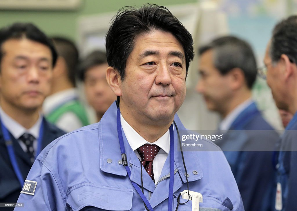 <a gi-track='captionPersonalityLinkClicked' href=/galleries/search?phrase=Shinzo+Abe&family=editorial&specificpeople=559017 ng-click='$event.stopPropagation()'>Shinzo Abe</a>, Japan's prime minister, walks through the emergency operations center at Tokyo Electric Power Co.'s (Tepco) Fukushima Dai-Ichi nuclear power plant in Okuma Town, Fukushima Prefecture, Japan, on Saturday, Dec. 29, 2012. All but two of Japan's 50 nuclear reactors remain offline for safety checks following the Fukushima nuclear disaster on March 11 last year. Photographer: Itsuo Inouye/Pool via Bloomberg