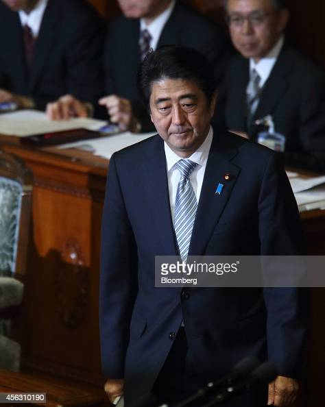 Shinzo Abe Japan's prime minister walks to the podium before delivering a policy speech during an extraordinary session at the lower houses of the...