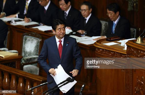 Shinzo Abe Japan's prime minister walks to the podium to deliver his policy speech at the lower house of parliament in Tokyo Japan on Thursday Feb 12...