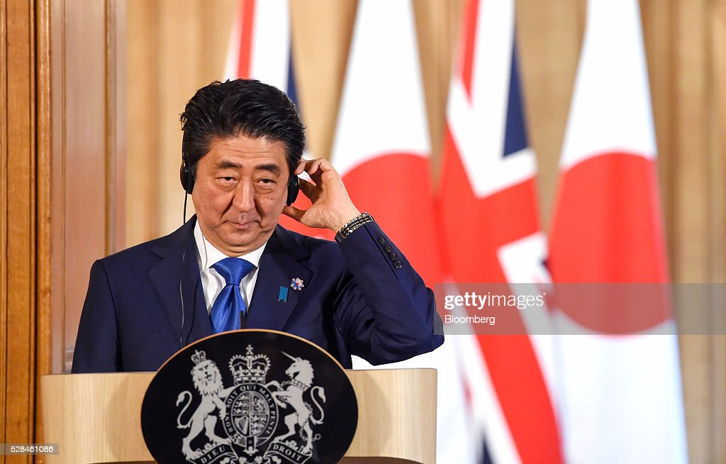 <a gi-track='captionPersonalityLinkClicked' href=/galleries/search?phrase=Shinzo+Abe&family=editorial&specificpeople=559017 ng-click='$event.stopPropagation()'>Shinzo Abe</a>, Japan's primer minister, adjusts his earpiece during a joint news conference with David Cameron, U.K. prime minister, inside number 10 Downing Street in London, U.K., on Thursday, May 5, 2016. Abe is discussed Japanese-European relations at the news conference. Photographer: Facundo Arrizabalaga/Pool via Bloomberg