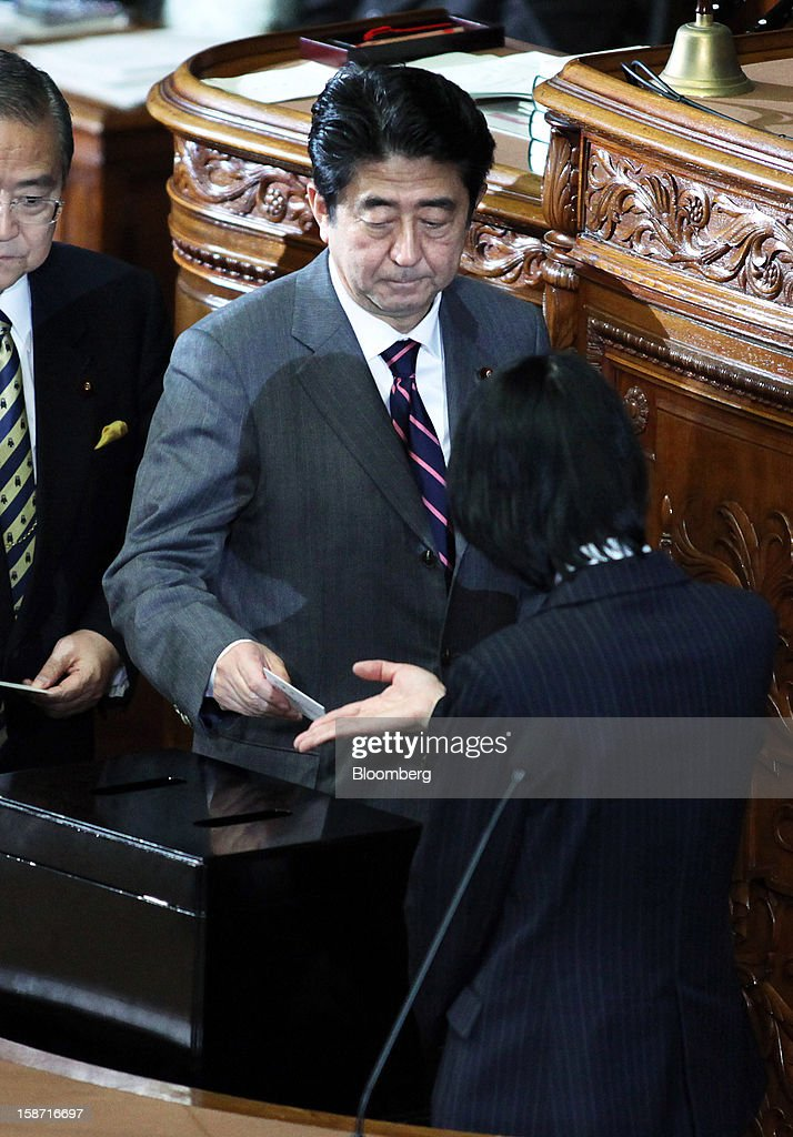 <a gi-track='captionPersonalityLinkClicked' href=/galleries/search?phrase=Shinzo+Abe&family=editorial&specificpeople=559017 ng-click='$event.stopPropagation()'>Shinzo Abe</a>, president of the Liberal Democratic Party (LDP), casts his ballot before being elected Japan's prime minister at the lower house of parliament in Tokyo, Japan, on Wednesday, Dec. 26, 2012. Japan's lower house confirmed Abe as the nation's seventh prime minister in six years, returning him to the office he left in 2007 after his party regained power in a landslide election victory last week. Photographer: Haruyoshi Yamaguchi/Bloomberg via Getty Images