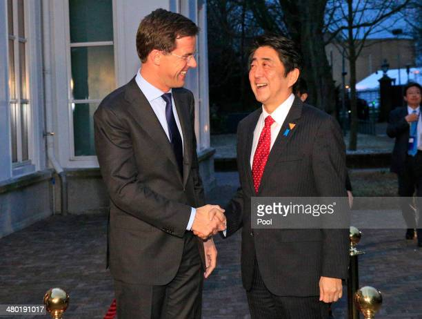 Shinzo Abe Prime Minister of Japan shakes hands with Mark Rutte Prime Minister of the Netherlands prior to a meeting ahead of the 2014 Nuclear...