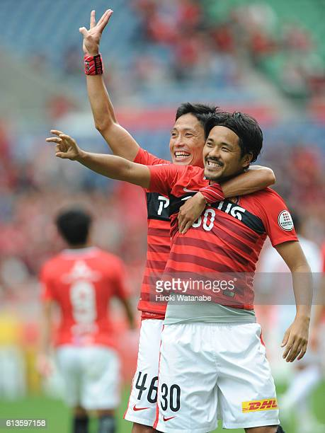 Shinzo Koroki and Ryota Moriwaki of Urawa Reds celebrate the three goai during the JLeague Levain Cup semi final second leg match between Urawa Red...