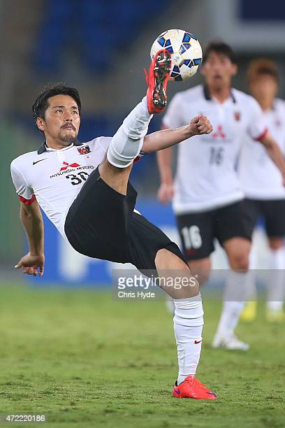 Shinzo Koroki of the Red Diamonds kicks during the Asian Champions League match between the Brisbane Roar and Urawa Red Diamonds at Cbus Super...