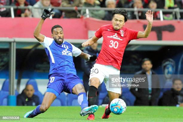 Shinzo Koroki of Urawa Red Diamonds and Mohammed Jahfali of AlHilal compete for the ball during the AFC Champions League Final second leg match...