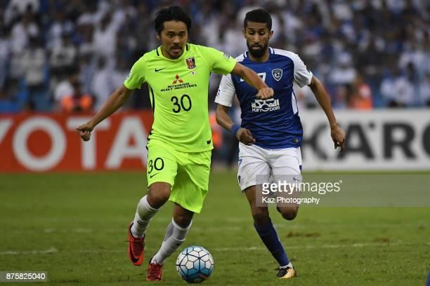 Shinzo Koroki of Urawa Red Diamonds and Salman Al Faraj of AlHilal compete for the ball during the AFC Champions League Final 2017 first leg between...