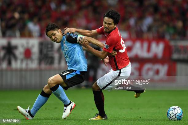 Shinzo Koroki of Urawa Red Diamonds and Yu Kabayashi of Kawasaki Frontale compete for the ball during the AFC Champions League quarter final second...