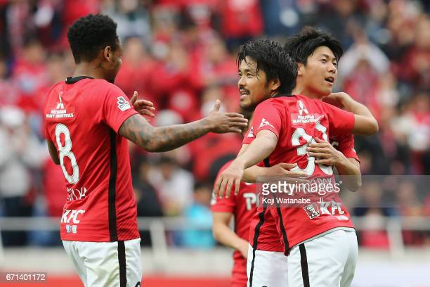 Shinzo Koroki of Urawa Red Diamonds celebrates his side's third goal with his team mates Rafael Silva and Yuki Muto during the JLeague J1 match...