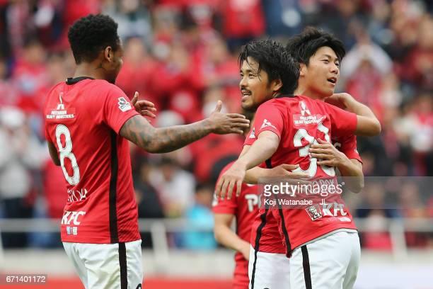 Shinzo Koroki of Urawa Red Diamonds celebrates his side's third goal with his team mates Rafael Silva and Yuki Muto during the JLeague J1 match...