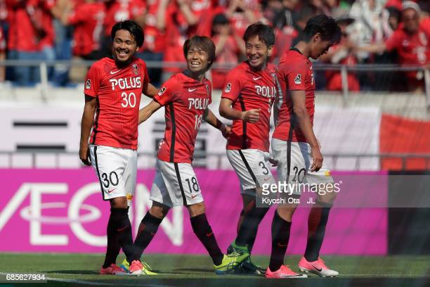 Shinzo Koroki of Urawa Red Diamonds celebrates scoring his side's second goal with his team mates during the JLeague J1 match between Urawa Red...
