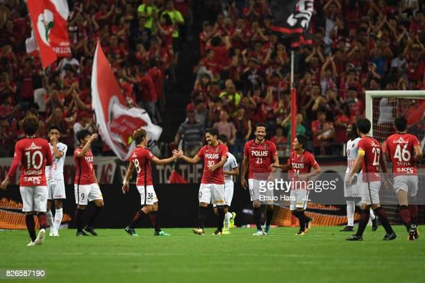 Shinzo Koroki of Urawa Red Diamonds celebrates scoring the opening goal with his team mates during the JLeague J1 match between Urawa Red Diamonds...