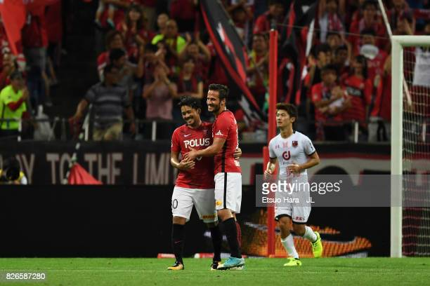 Shinzo Koroki of Urawa Red Diamonds celebrates scoring the opening goal with his team mate Zlatan Ljubijankic during the JLeague J1 match between...