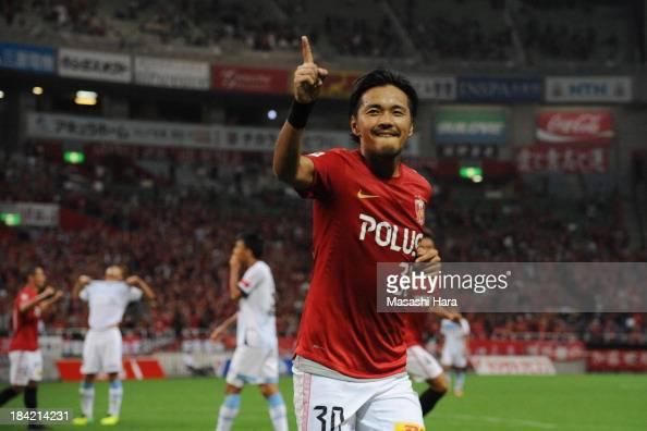 Shinzo Koroki of Urawa Red Diamonds celebrates the first goal during the Yamazaki Nabisco Cup semi final second leg match between Urawa Red Diamonds...