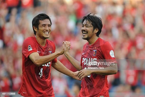 Shinzo Koroki of Urawa Red Diamonds celebrates the first goal with a team mate during the JLeague match between Urawa Red Diamonds and Sagan Tosu at...