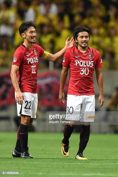 Shinzo Koroki of Urawa Red Diamonds celebrates with his team mate after scoring a goal during the preseason friendly match between Urawa Red Diamonds...