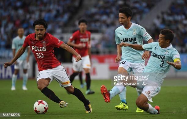 Shinzo Koroki of Urawa Red Diamonds goes past Kentaro Oi of Jubilo Iwata during the JLeague J1 match between Jubilo Iwata and Urawa Red Diamonds at...