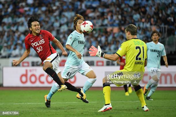 Shinzo Koroki of Urawa Red Diamonds heads the ball to score his side's first goal past Krzysztof Kaminski of Jubilo Iwata during the JLeague J1 match...
