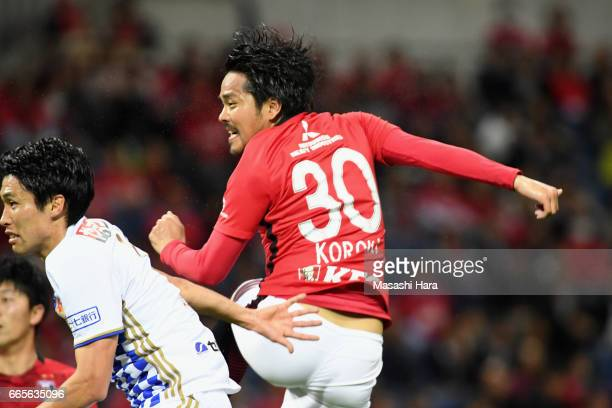 Shinzo Koroki of Urawa Red Diamonds heads to score the opening goal during the JLeague J1 match between Urawa Red Diamonds and Vegalta Sendai at...