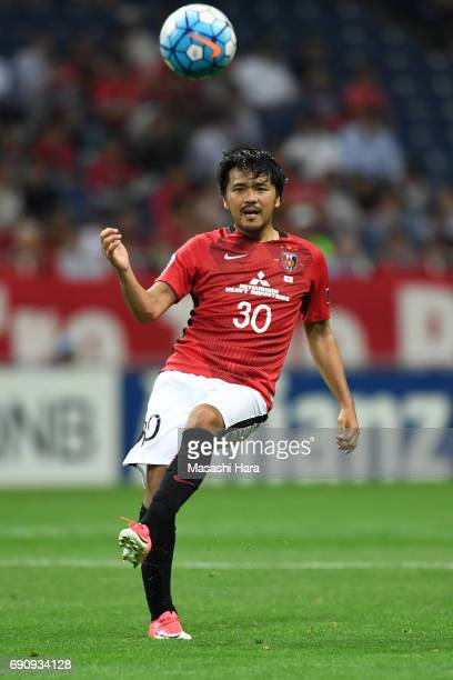 Shinzo Koroki of Urawa Red Diamonds in action during the AFC Champions League Round of 16 match between Urawa Red Diamonds and Jeju United FC at...
