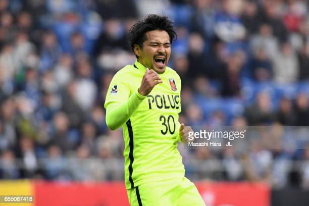 Shinzo Koroki of Urawa Red Diamonds reacts after missing a chance during the JLeague J1 match between Gamba Osaka and Urawa Red Diamonds at Suita...
