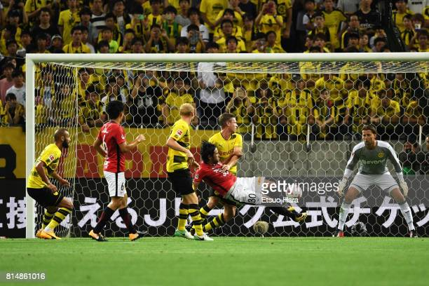 Shinzo Koroki of Urawa Red Diamonds scores his side's first goal during the preseason friendly match between Urawa Red Diamonds and Borussia Dortmund...