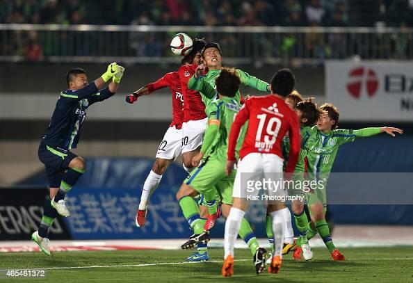 Shinzo Koroki of Urawa Red Diamonds scores his team's first goal during the J League match between Shonan Bellmare and Urawa Red Diamonds at Shonan...