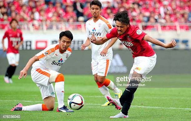Shinzo Koroki of Urawa Red Diamonds scores his team's first goal during the JLeague match between Urawa Red Diamonds and Shimizu SPulse at Saitama...