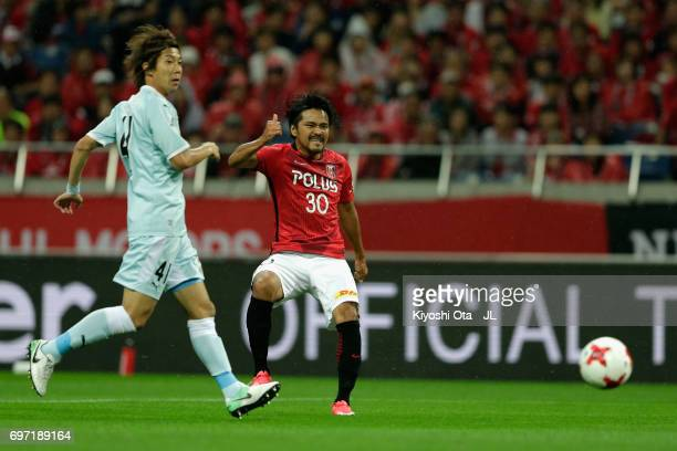 Shinzo Koroki of Urawa Red Diamonds shoots at goal during the JLeague J1 match between Urawa Red Diamonds and Jubilo Iwata at Saitama Stadium on June...