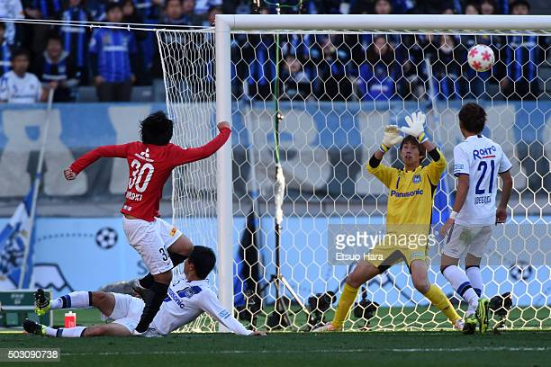 Shinzo Koroki of Urawa Red Diamonds#30 scores his team's first goal during the 95th Emperor's Cup final between Urawa Red Diamonds and Gamba Osaka at...