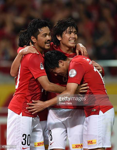 Shinzo Koroki of Urawa Reds celebrates scoring his team's fourth goal with his team mates Yosuke Kashiwagi and Yuki Muto during the JLeague match...