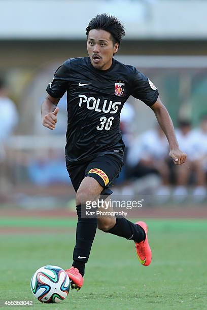Shinzo Koroki of Urawa Reds in action during the JLeague match between Shimizu SPulse and Urawa Red Diamonds at Ecopa Stadium on September 13 2014 in...