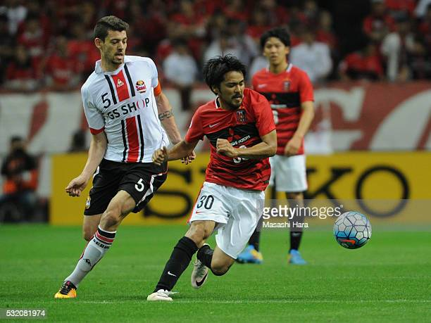 Shinzo Koroki of Urrawa Red Diamonds in action during the AFC Champions League Round of 16 First Leg match between Urawa Red Diamonds and FC Seoul at...