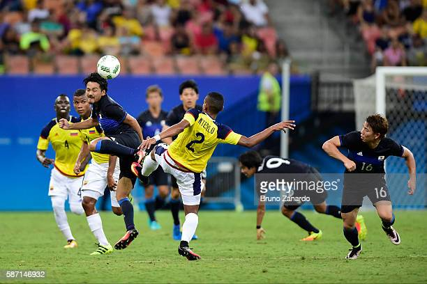 Shinzo Koroki player of Japan battles for the ball with William Tesillo player of Colombia during 2016 Summer Olympics match between Japan and...