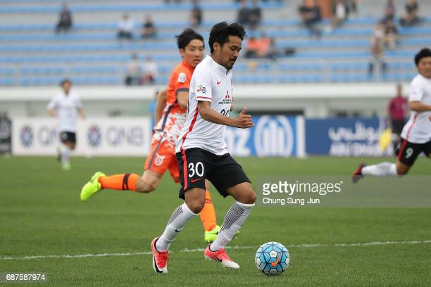 Shinzoh Kohrogi of Urawa Red Diamonds controls the ball during the AFC Champions League Round of 16 match between Jeju United FC and Urawa Red...