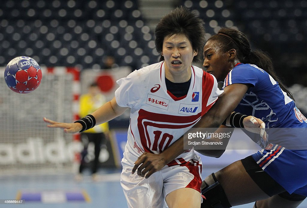 Shio Fujii (L) of Japan is challenged by <a gi-track='captionPersonalityLinkClicked' href=/galleries/search?phrase=Mariama+Signate&family=editorial&specificpeople=2206555 ng-click='$event.stopPropagation()'>Mariama Signate</a> (R) of France during the 2013 World Women's Handball Championship 2013 match between France and Japan at Kombank Arena Hall on December 15, 2013 in Belgrade, Serbia.
