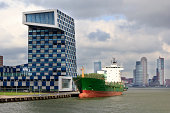 Ship at quayside and cityscape, Rotterdam