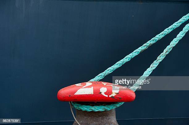 A ship bollard with a green rope tied to it, Angola, Luanda Bay