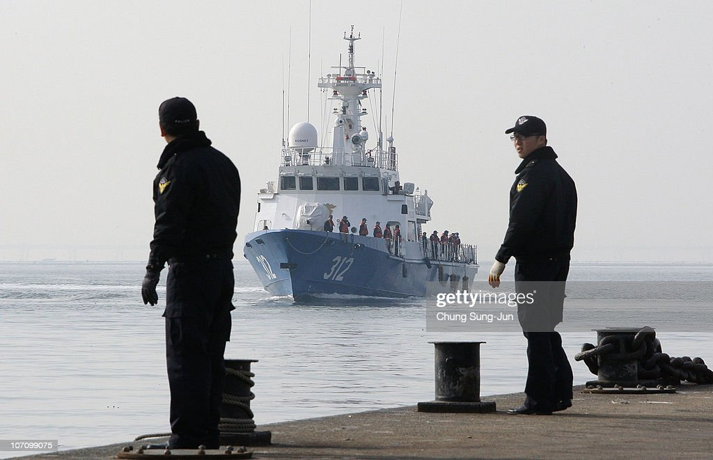 A ship carry survivors of the artillery exchange between North and South Korea sails into Incheon port from Yeonpyeong Island on November 24 2010 in...
